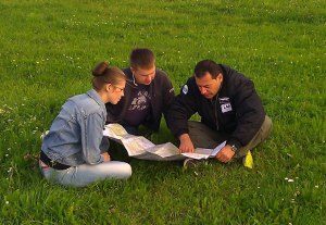 Briefing before departure, laying a course on the map